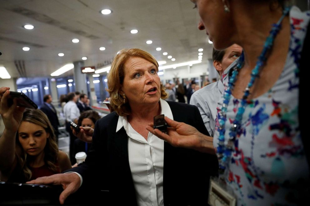 PHOTO: Sen. Heidi Heitkamp speaks with reporters ahead of the weekly policy luncheons on Capitol Hill in Washington, July 24, 2018.