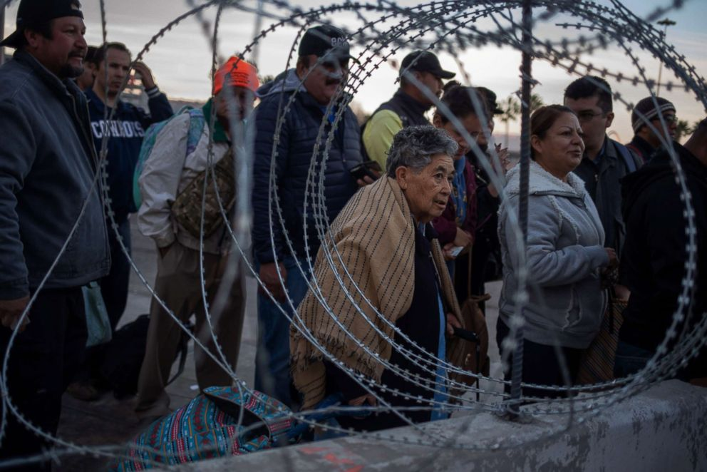 PHOTO: Concertina wire is pictured as people wait in line at the San Ysidro Port of Entry after the land border crossing was temporarily closed to foot and vehicle traffic from Tijuana, Mexico, Nov. 19, 2018.