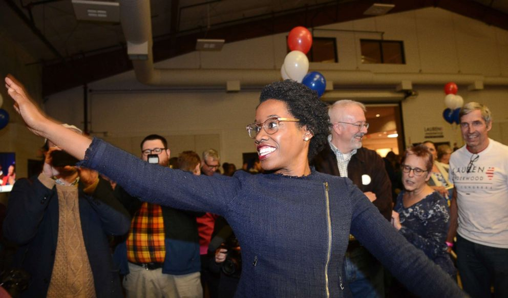 PHOTO:Lauren Underwood, the Democratic candidate in Illinois 14th District, visits with others at her election night party in St. Charles, Ill., Nov. 6, 2018.