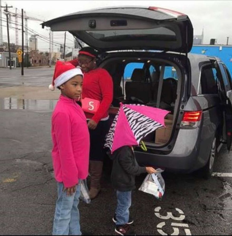 PHOTO: Latiaa Stewarts three children help her hand out care packages.