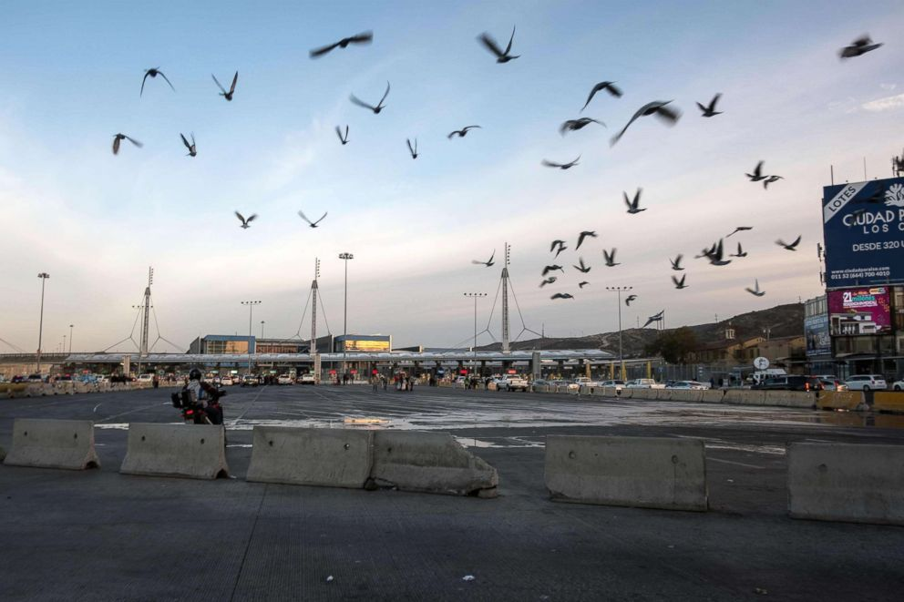 PHOTO: Birds fly over almost empty border crossing lines, after U.S. authorities temporarily closed the San Ysidro port of entry at the US-Mexico border, as seen from Tijuana, Mexico, Nov. 19, 2018.