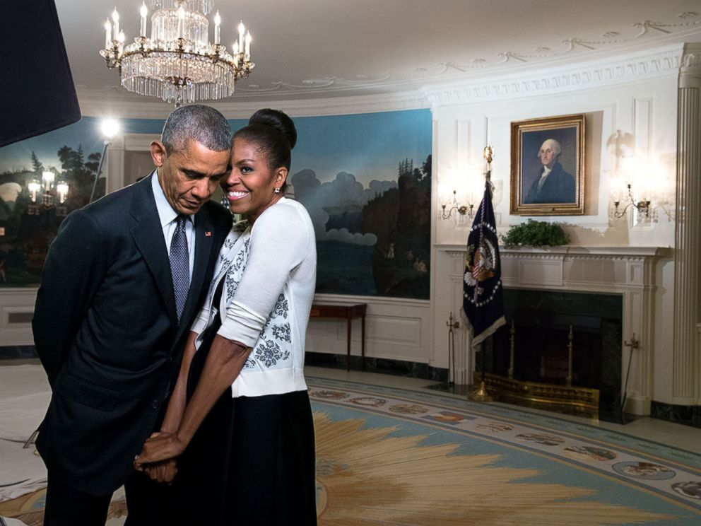 PHOTO: First lady Michelle Obama snuggles with President Barack Obama during a video taping in the Diplomatic Reception Room of the White House, March 27, 2015.