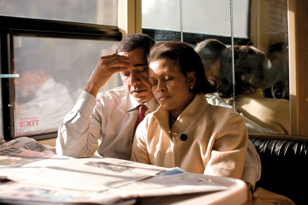 PHOTO: Michelle Obama and her husband, Senator and Presidential Candidate Barack Obama, on his campaign bus the morning of the New Hampshire primary driving from Hanover to Nashua, N.H. They had a early morning rally after a late night of campaigning.